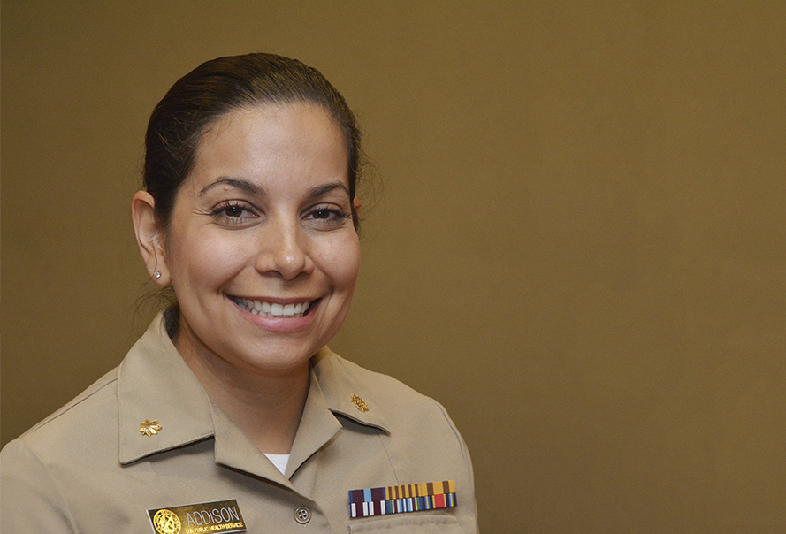 Woman smiling wearing military uniform
