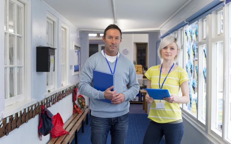 Teachers standing in a school hallway