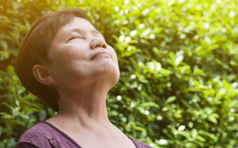 senior woman relaxing and breathing fresh air